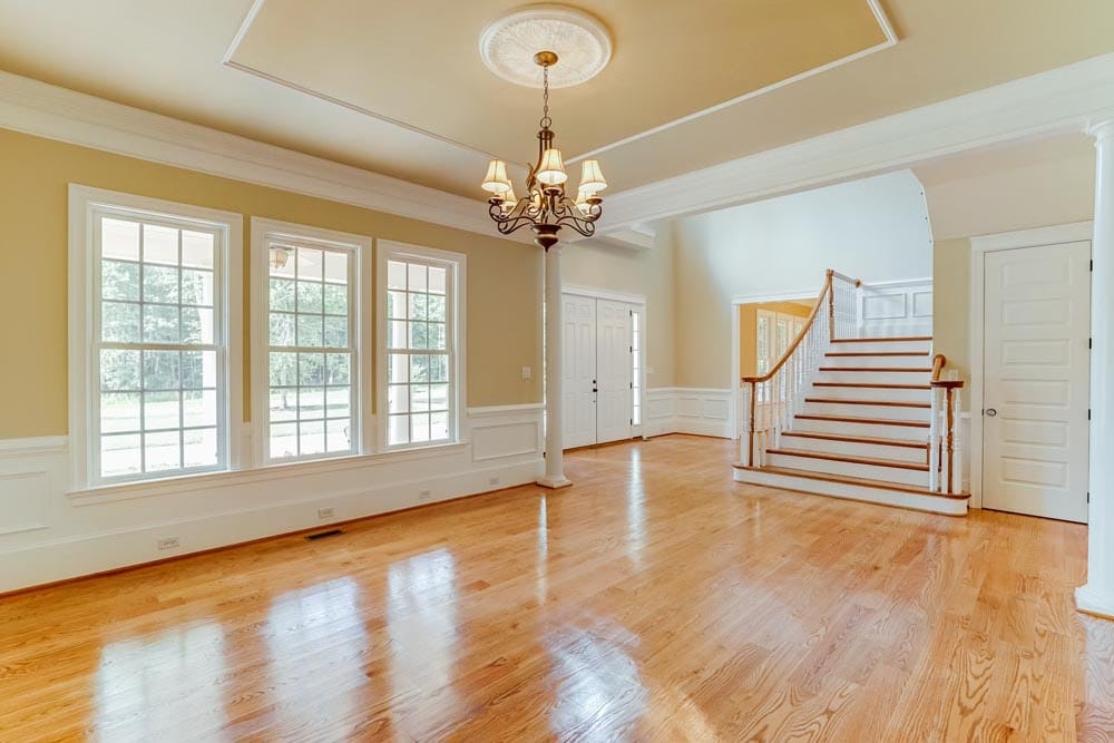 Lobby in front of Middleburg house with chandelier, 3 windows, and stairs