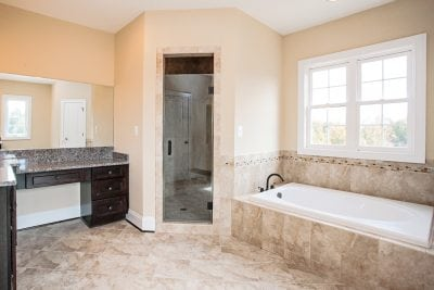 Manassas master bathroom with bathtub and shower