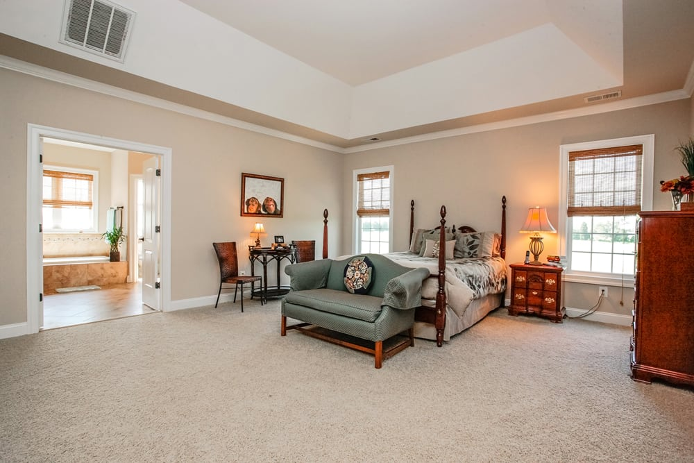 Master bedroom in Nokesville home furnisehd with large bed