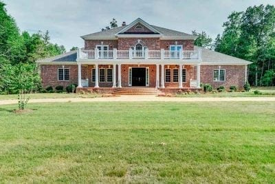 Middleburg brick home with black double doors