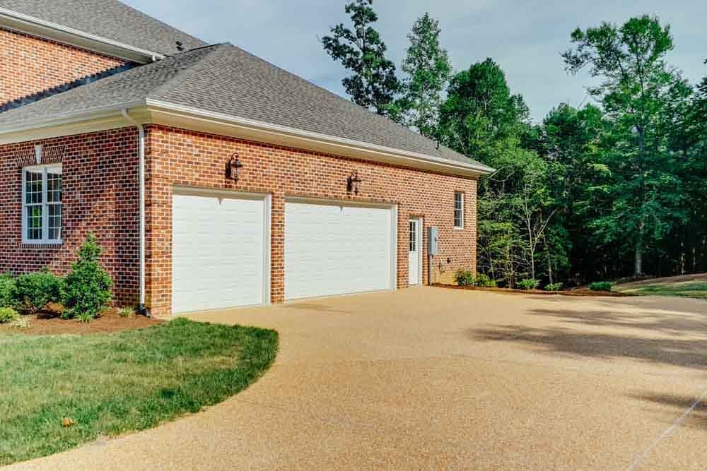 Middleburg home driveway leading into garages