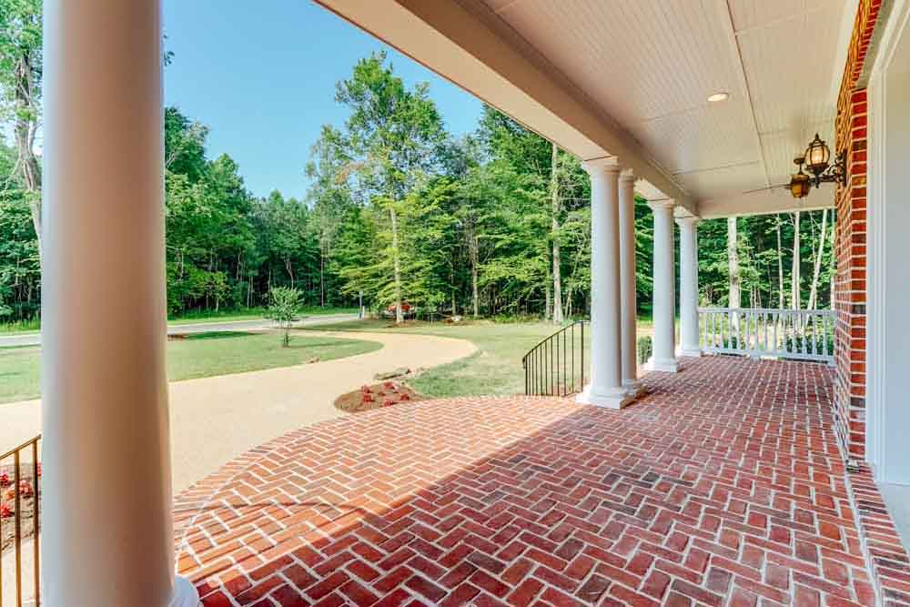 Middleburg home front brick porch with pillars and walkway