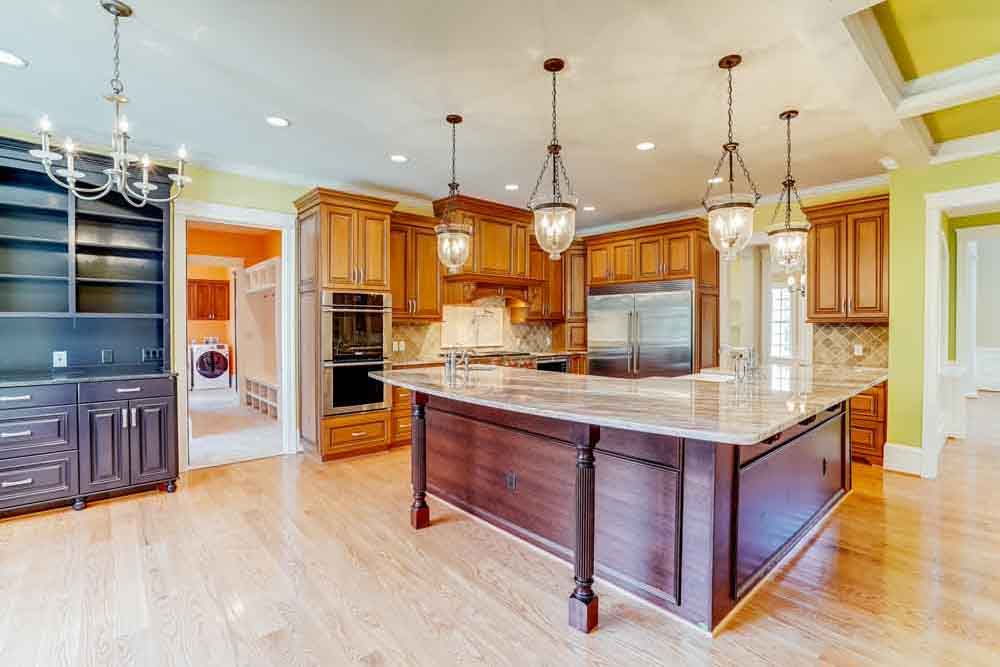 Middleburg home kitchen island with countertop for seating and a large cabinet area of darker stained wood