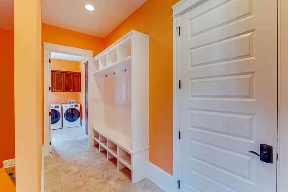 Middleburg home laundry room and small hallway next to it for hanging jackets and placing shoes