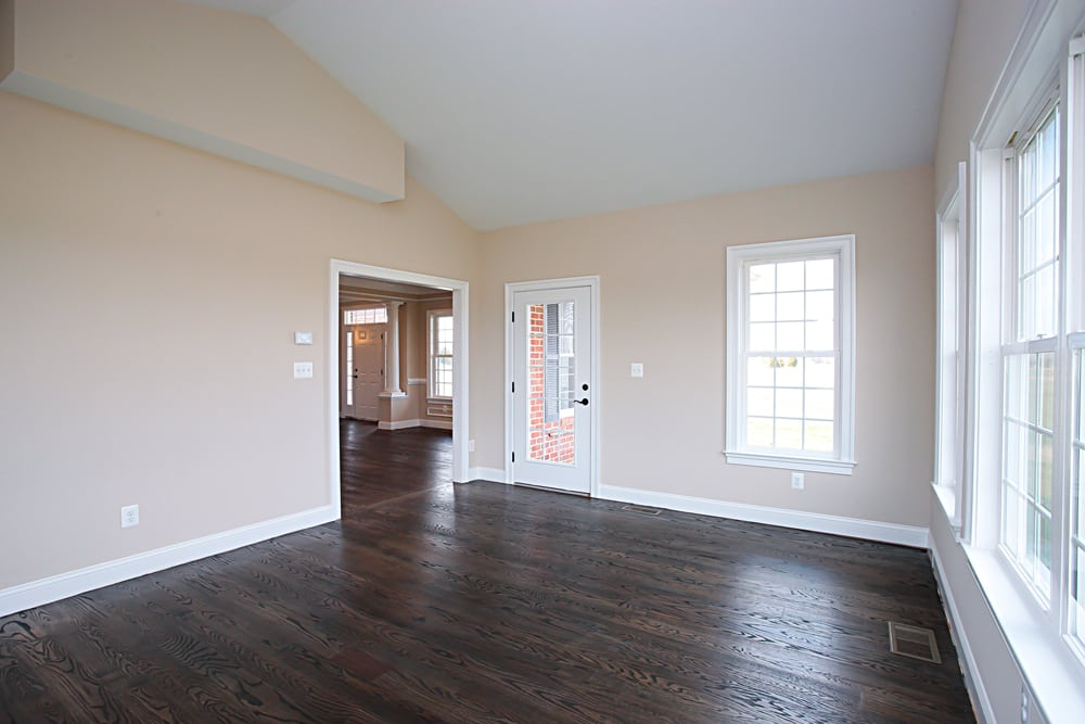 Nokesville home room with many windows and a glass paneled door leading to the outside