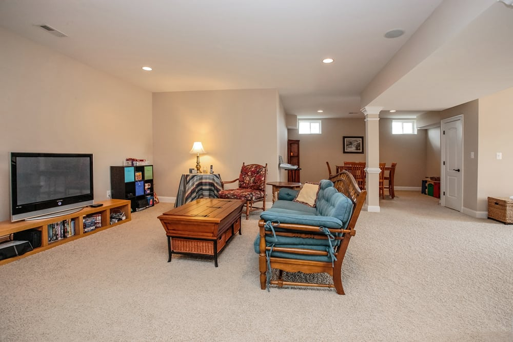 Other part of Nokesville basement with furniture and television
