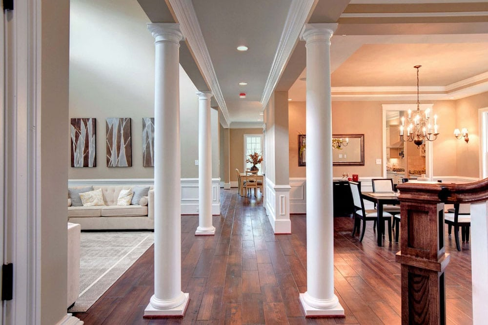 Pillared walkway in Fairfax home separating sitting room and dining room