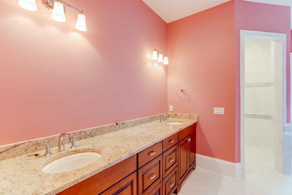 Pink Middleburg bathroom with granite countertop sinks
