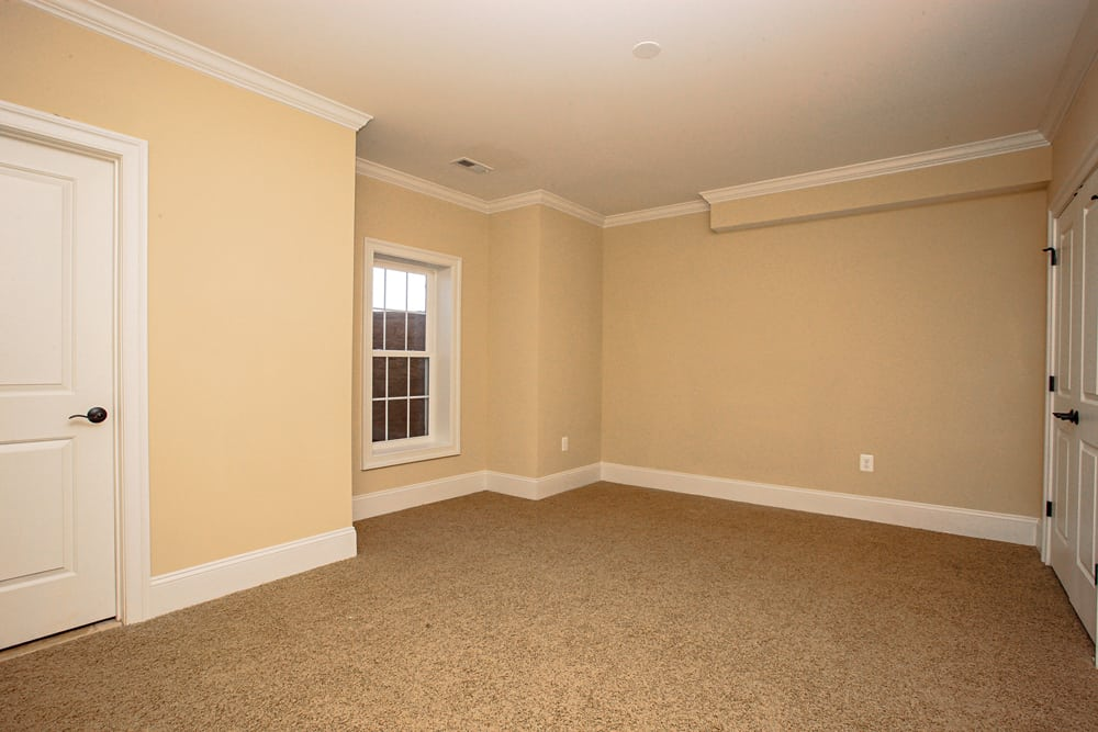 Room in Leesburg home with closet and window and beige walls
