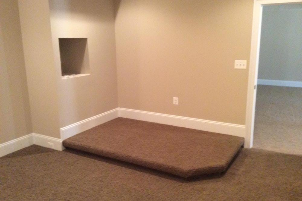 Room in Round Hill home with a raised area