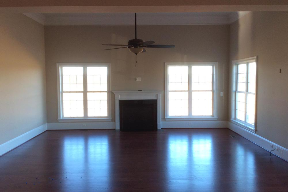 Room with ceiling fan, windows, and fireplace in a house on The Plains