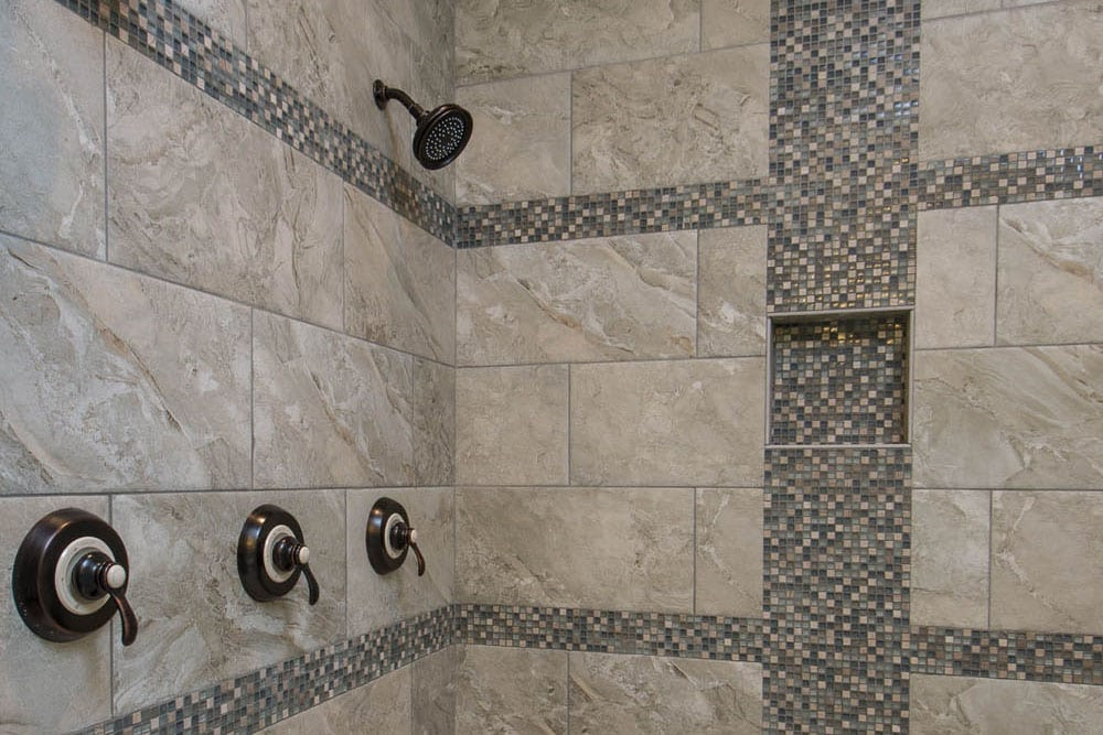 Shower for two with two heads next to each other in Fairfax bathroom