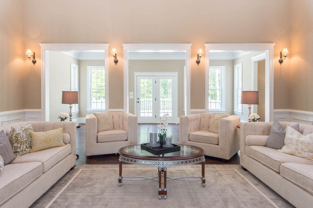 Sitting room in Fairfax home with glass paneled double doors leading to deck