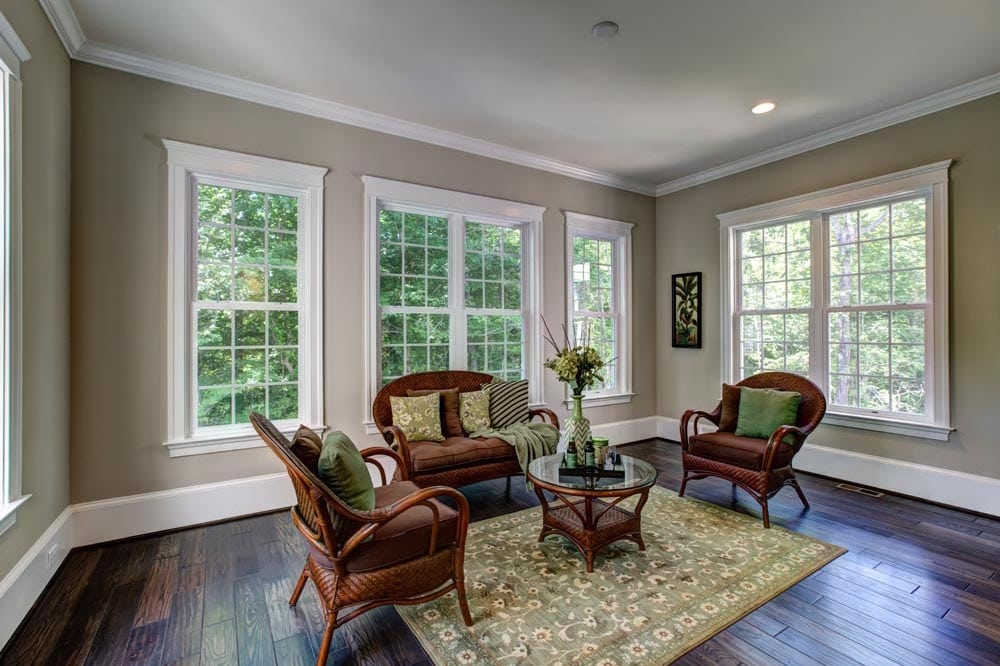 Small windowed room with wicker furniture