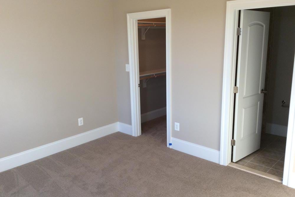 View of closet and door in a house on The Plains with white carpet