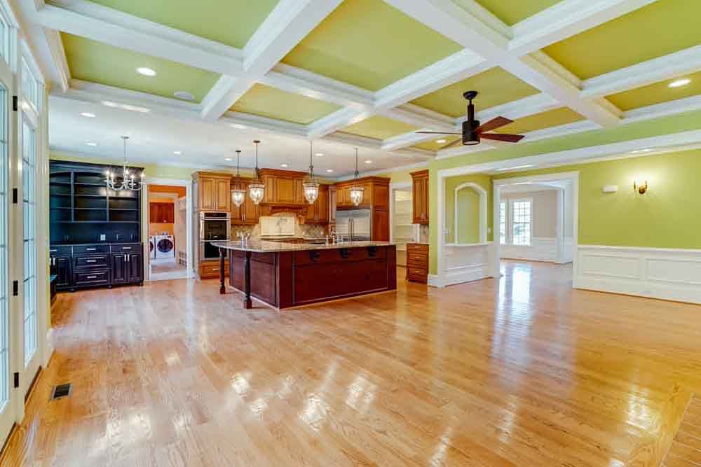 View of kitchen and family space in Middleburg home from large paneled glass doors