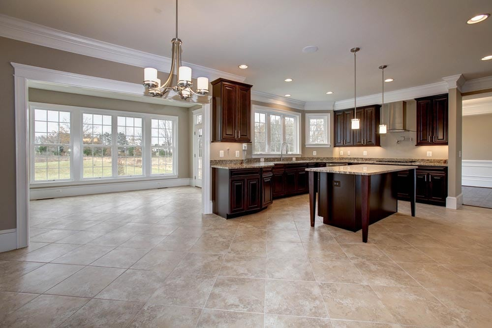 View of kitchen and many windowed room in Culpeper home