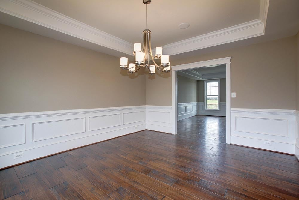 View of other side of Culpeper dining room with chandelier and stained wood floors
