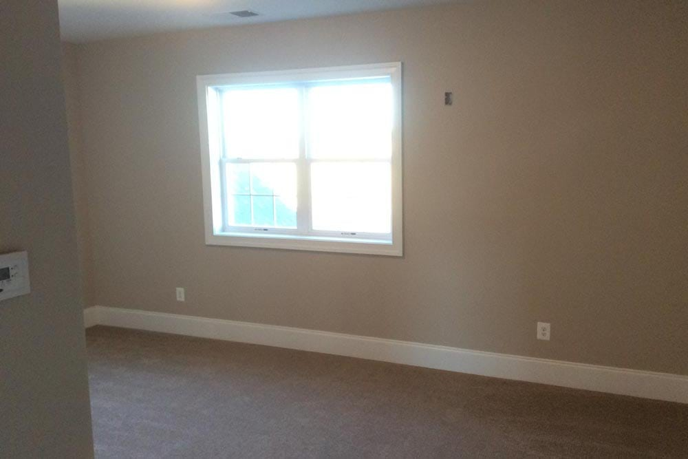 View of room with window and white carpet in a house on The Plains