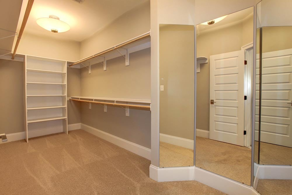 Walk in closet with shelves and 3 panel mirror in Culpeper home