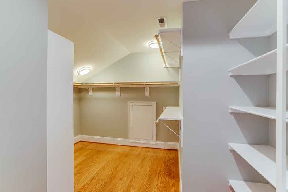 Walkin closet and storage space with white shelves