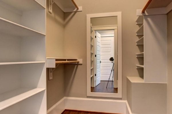 Walkin closet with shelves and a mirror in Haymarket home