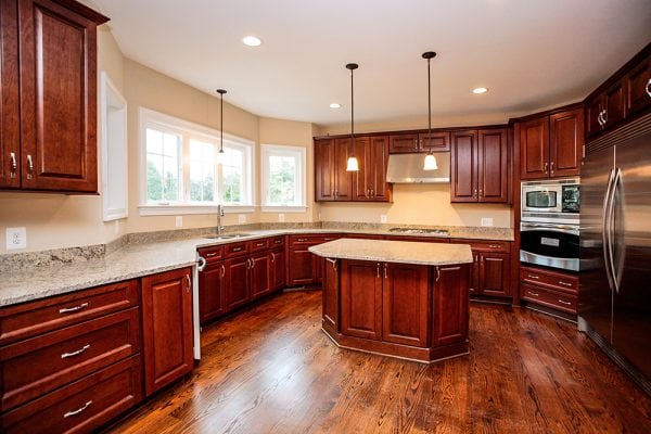 Warrenton kitchen with hanging lights and island