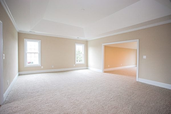 White carpet room with two big windows inside Warrenton house
