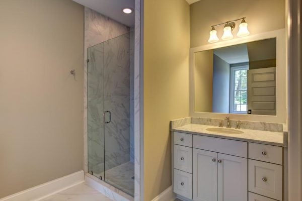White guest bathroom with shower in Haymarket house