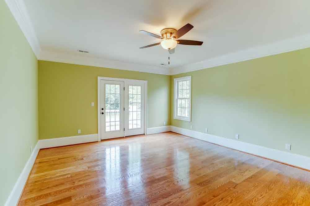 Yellow-green room with light and fan and windows in Middleburg home
