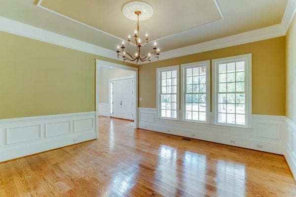 Yellow-ish walled room with chandelier in Middleburg home
